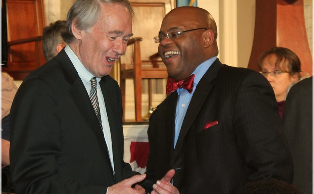Sen. Mo Cowan, Trinity '91,(r) chats with Rep. Ed Markey, D-Mass. at an event celebrating the career of John Kerry.