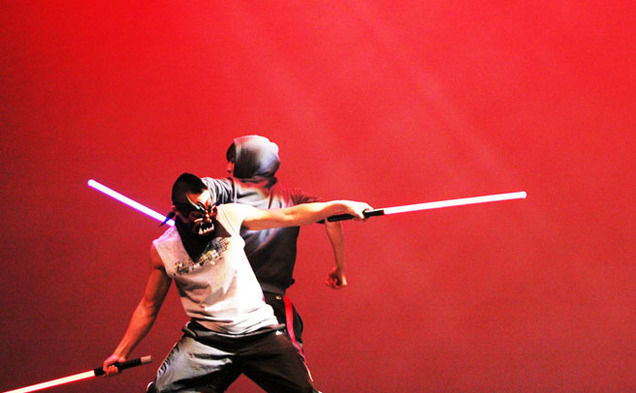 Two students perform comedic martial arts with lightsabers at the Lunar New Year celebration in Page Auditorium Saturday night.