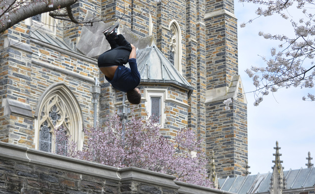 Senior David Ivey flips off a wall near the Duke chapel.
