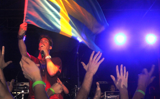 Musician Basshunter waves a Swedish flag while performing for a crowd at the Spring 2012 LDOC celebration. This year's LDOC committee just began meeting to plan the Spring 2013 celebration.