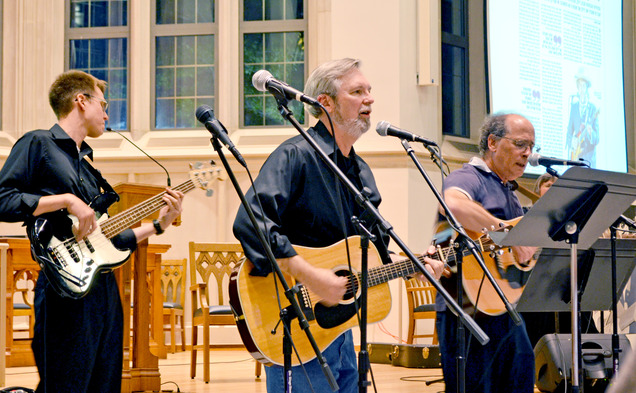 Faculty jam out to a repertoire of Bob Dylan songs at Goodson Chapel Thursday.