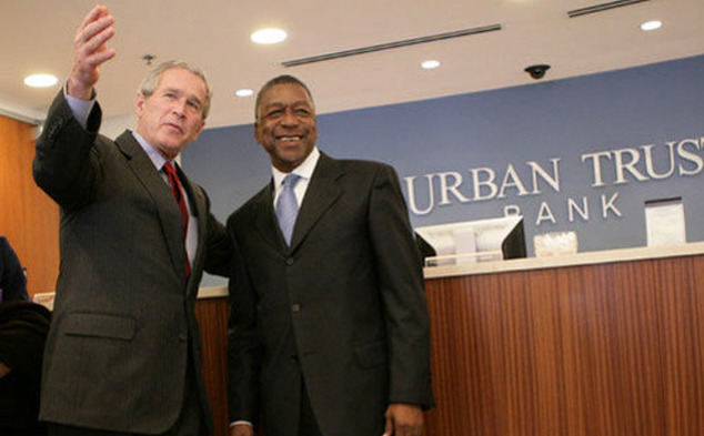 BET Founder Bob Johnson, shown with former President George W. Bush, spoke about his rise to success at the Fuqua School of Business Friday.