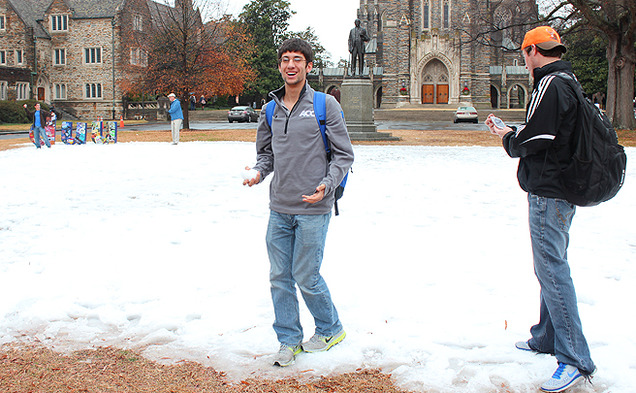 Students take a break to play in the snow before buckling down for finals. Several inches of man-made snow covered the Chapel Quadrangle Friday morning, in an event sponsored by Duke University Union.