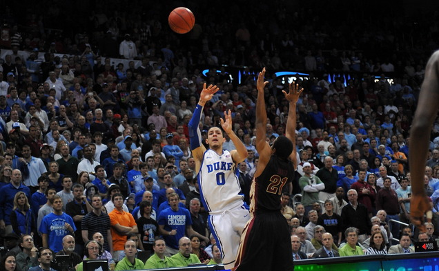 Austin River heaves a three-point shot in the closing minute of the ACC semi finals.