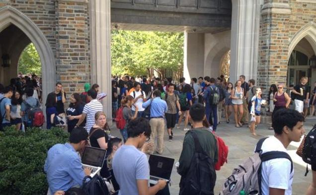 Students gathered outside Perkins and Bostock Libraries following a false fire alarm Wednesday afternoon.