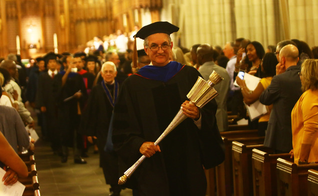 Joshua Socolar, chair of Academic Council, walks away from the alter after the Founders' Day convocation.